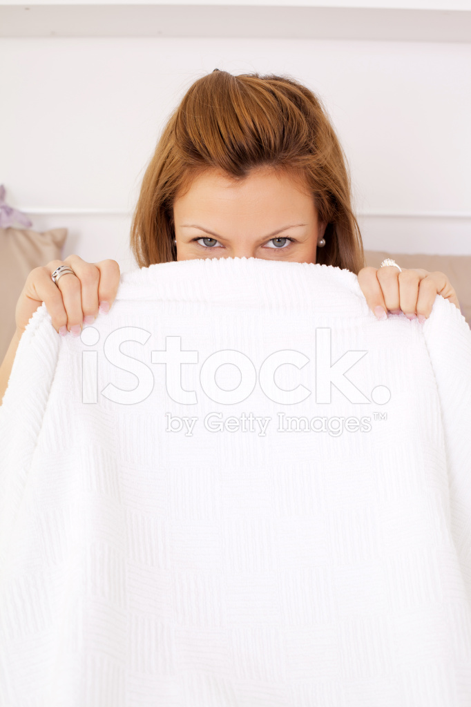 https://images.freeimages.com/images/premium/previews/1968/19688609-woman-peeking-out-from-under-the-blanket.jpg