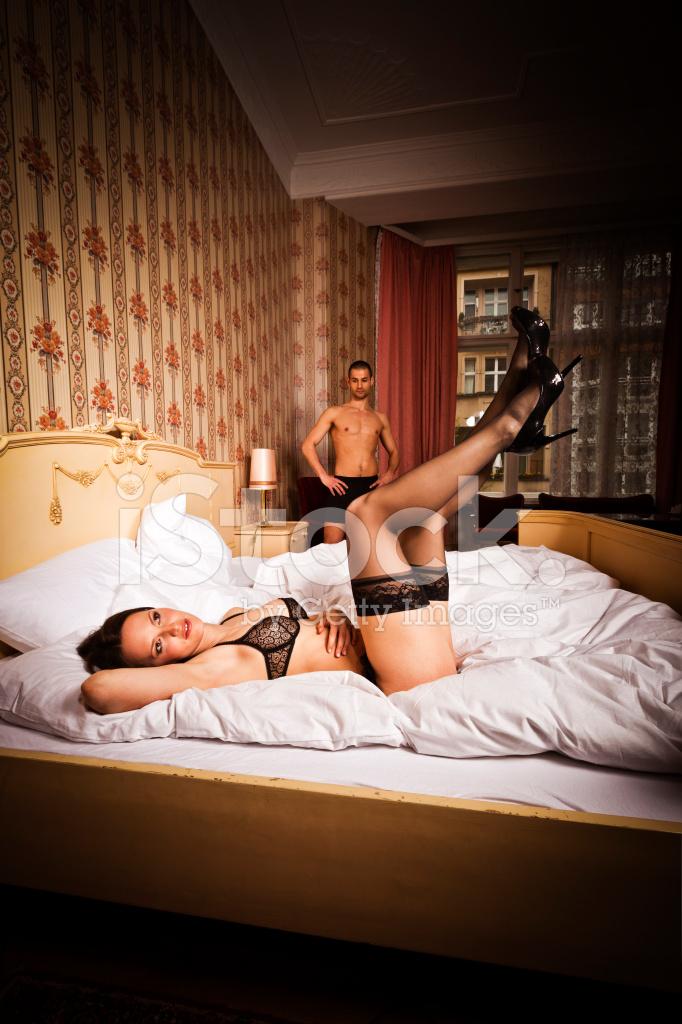 couple in hotel bedroom stock photos