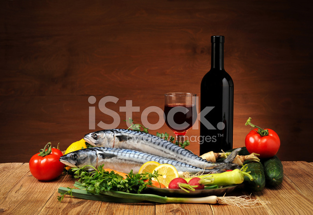 Fish with vegetables and wine stock photos for Pesce rosso butterfly