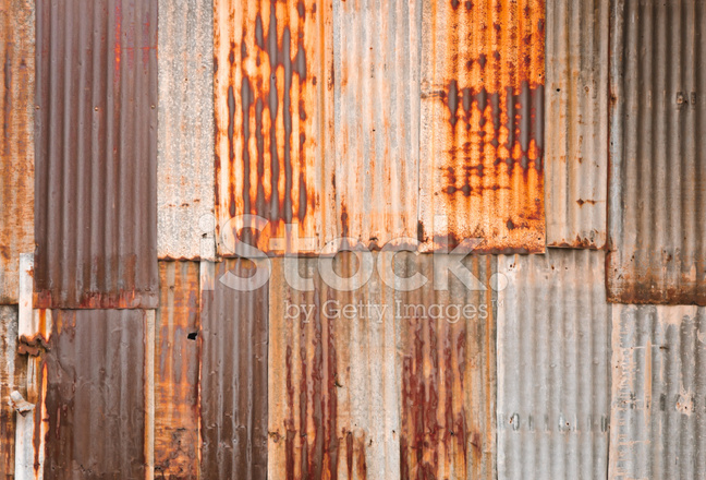 Rusted corrugated metal fence Rock Filled Premium Stock Photo Of Rusty Corrugated Metal Wall Areckoning Film Rusty Corrugated Metal Wall Stock Photos Freeimagescom