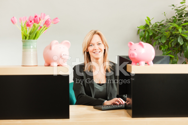 Friendly Woman Banker Working In Retail Banking Teller Window Hz