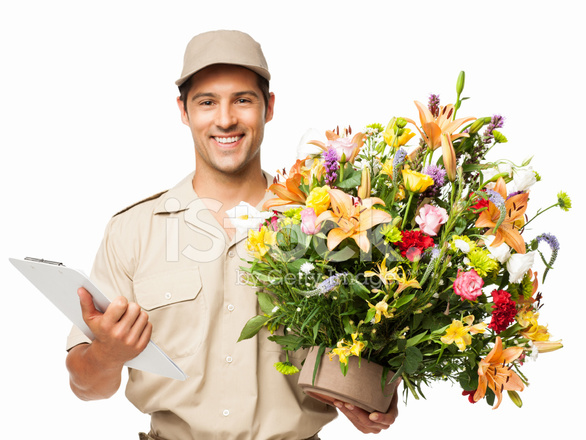 Delivery Man Holding Bouquet Of Flowers And Clipboard - Isolated
