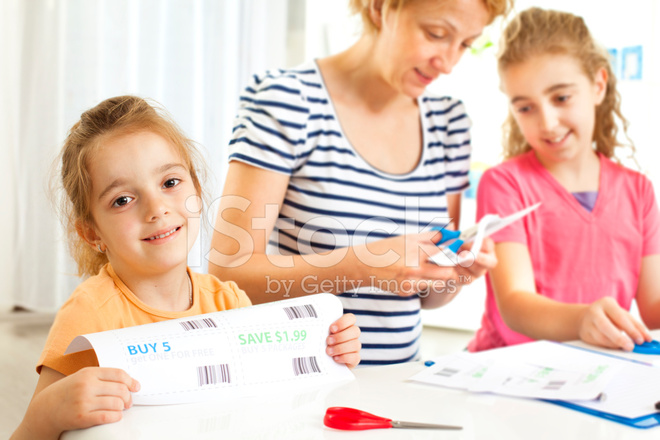 family making shopping list and coupons
