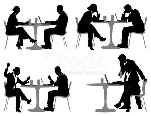 Silhouette Of Business Executives In A Restaurant Stock