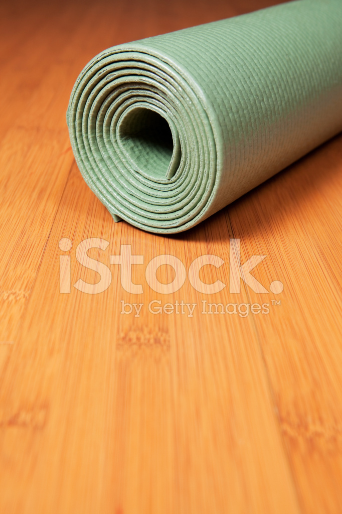 Rolled Green Yoga Mat On Bamboo Floor Stock Photos Freeimages Com