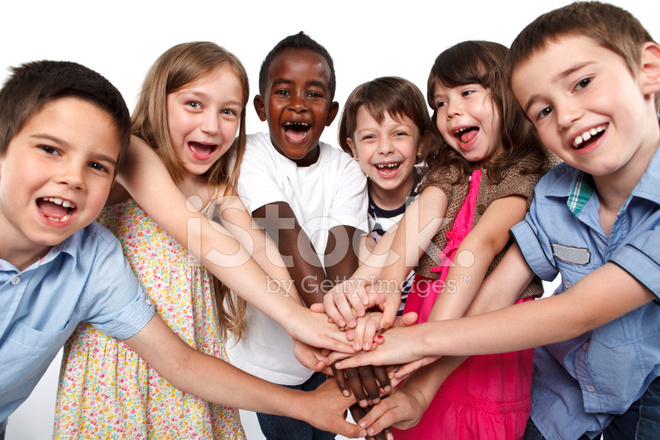 Multiracial Children Putting Their Hands Together Stock
