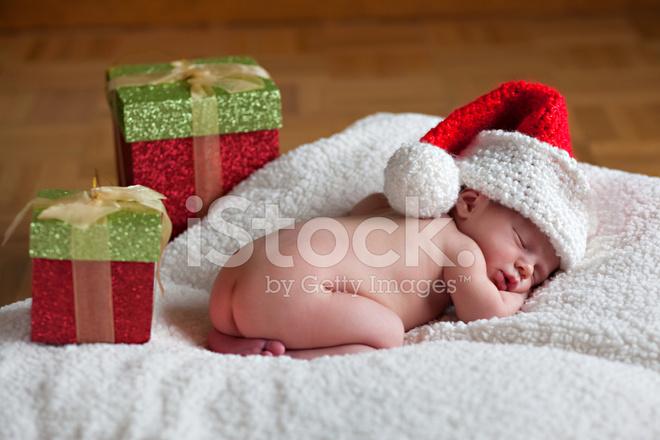 Newborn Baby Boy With Santa Hat and Christmas Presents Stock Photos ... e3abd075040