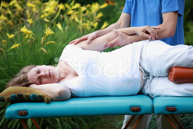 Pregnant Woman Arm Massage By Physical Therapist Stock
