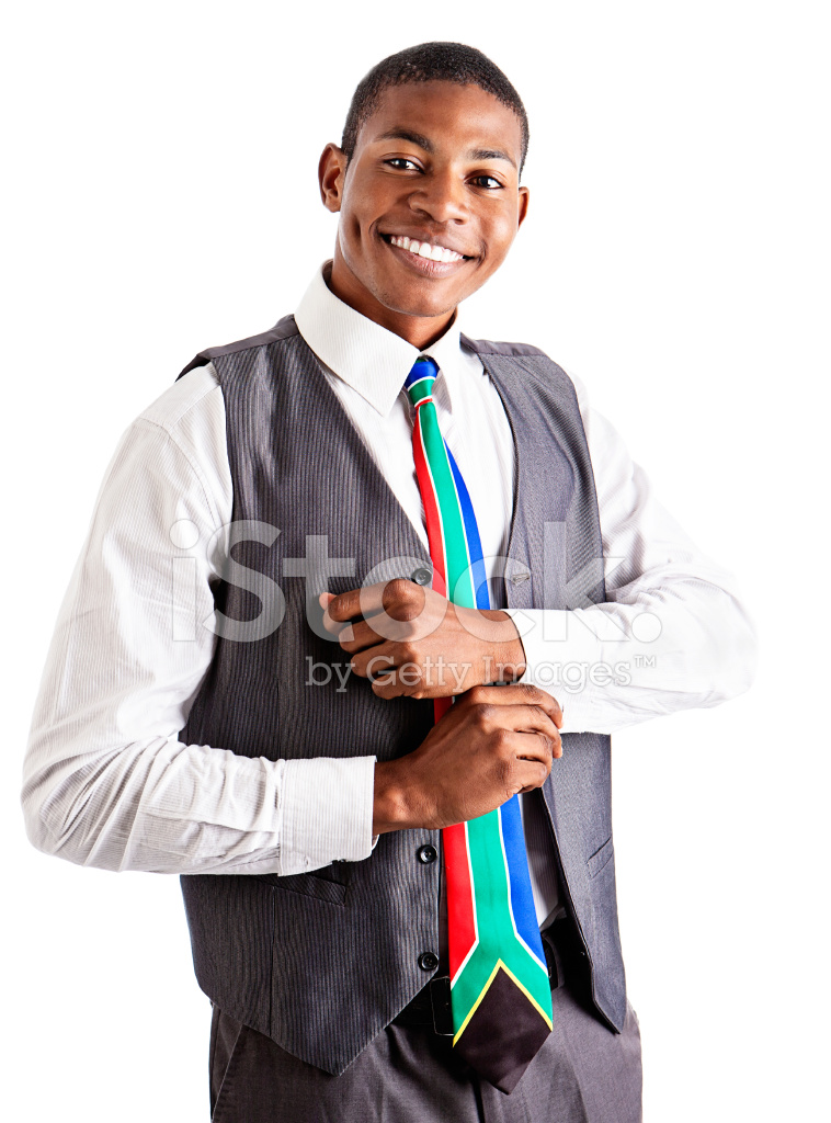 Handsome Young Formally Dressed Man Smiles Adjusting His Cuffs
