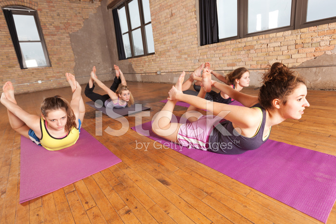 Young Women Practicing Bow Pose In Group Yoga Workout Exercise Stock Photos Freeimages Com