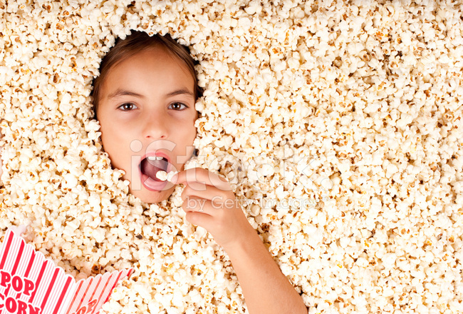 girl buried in popcorn stock photos   freeimages