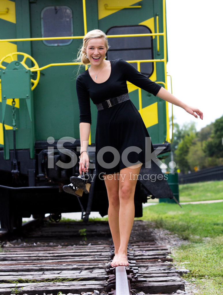 Barefoot Girl Walking On Railroad Tracks Stock Photos