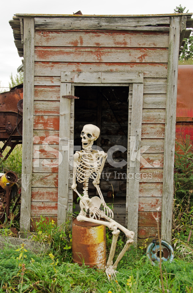 Skeleton Waiting Outside Outhouse Stock Photos