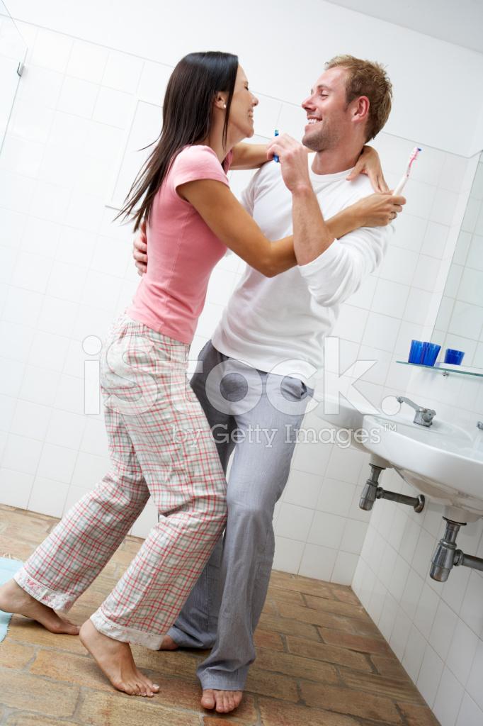 Couple Having Fun In Bathroom Brushing Teeth Stock Photos