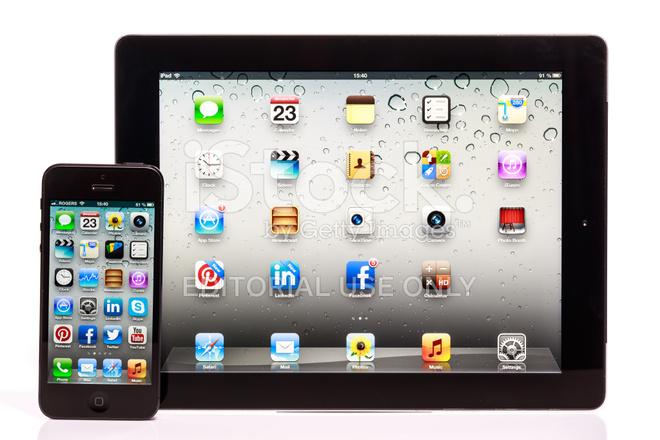 Apple Iphone 5 E Ipad Confronto Isolato Su Sfondo Bianco Fotografie