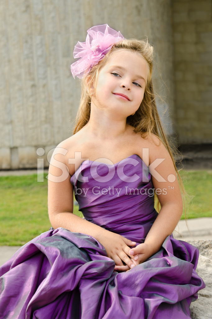 portrait of cute little girl in princess dress stock photos