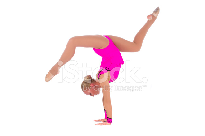 945a17dfe Smiling Flexible Girl Gymnast IN A Costume Doing Stretching Exer ...