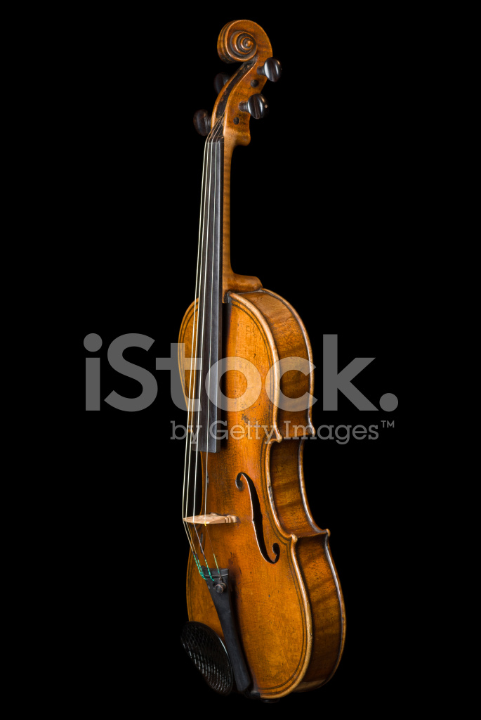 Old Violin Isolated on Black Vertical Oblique View Stock