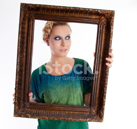 Attractive Girl Holding Frame Stock Photos - FreeImages.com