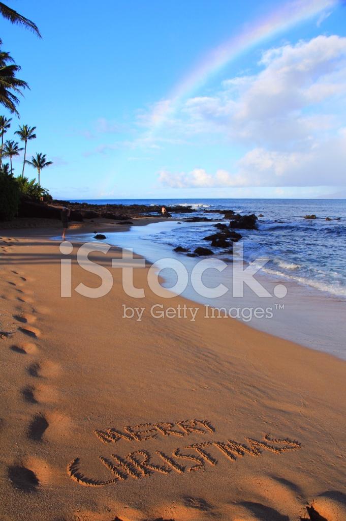 merry christmas written on maui hawaii beach sand with rainbow - Merry Christmas Beach