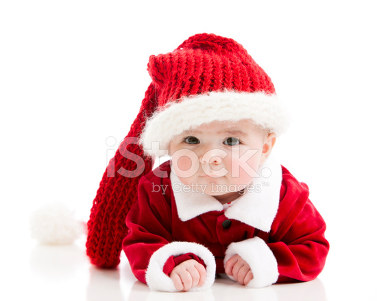 Baby Girl Dressed Santa Claus With Funny Long Stocking Cap Stock ... 734b5799df3