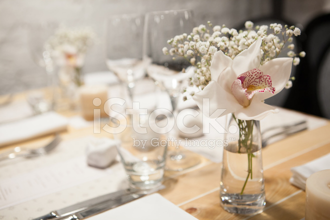 Birthday Reception Table Setting With Flowers And Candles