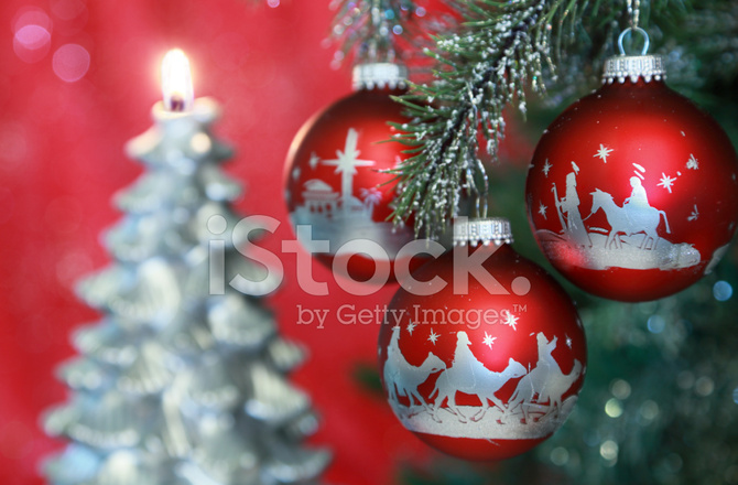 religious christmas nativity scene ornaments with tree in backg
