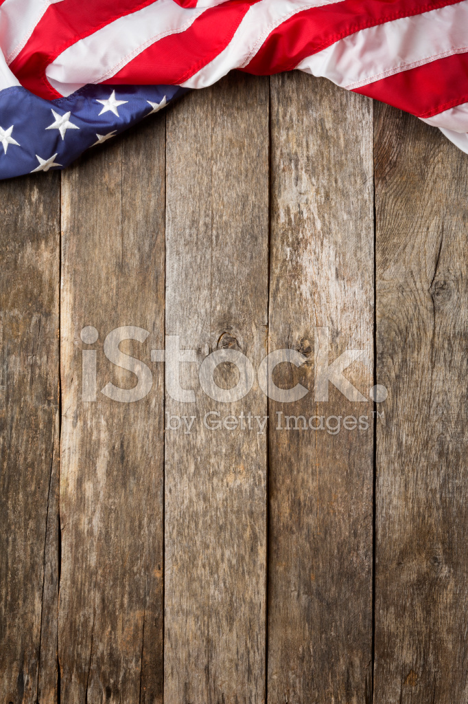 American Flag On Rustic Wooden Background