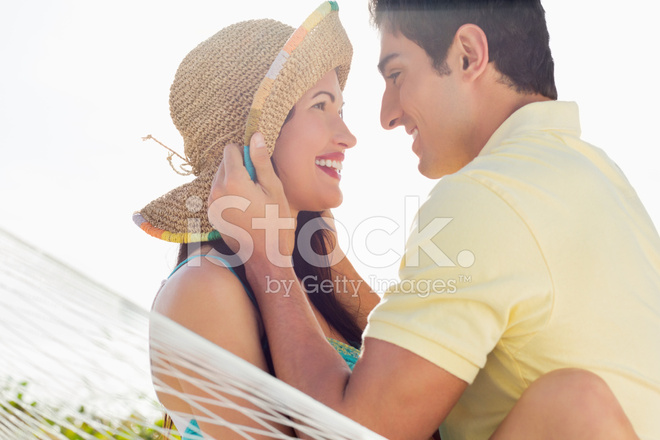 https://images.freeimages.com/images/premium/previews/2257/22573349-happy-loving-couple-looking-at-each-other-in-hammock.jpg