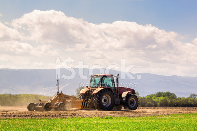 Tractor and Laser Guided Land Leveler Stock Photos