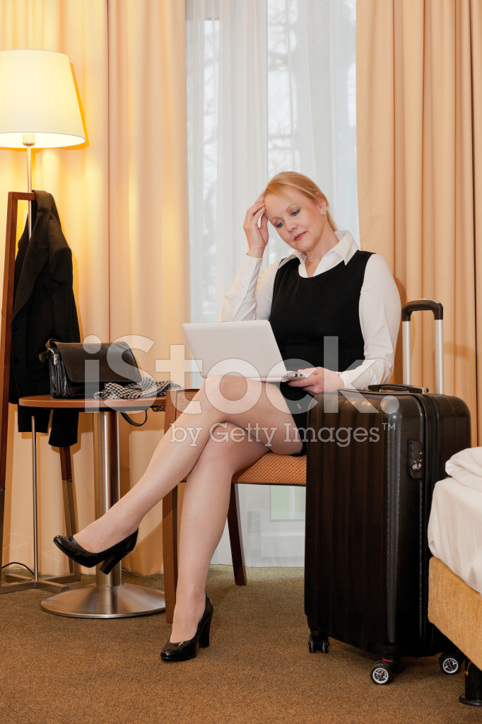 Hotel Room Photography: Traveling Businesswoman Using Laptop IN Hotel Room Stock