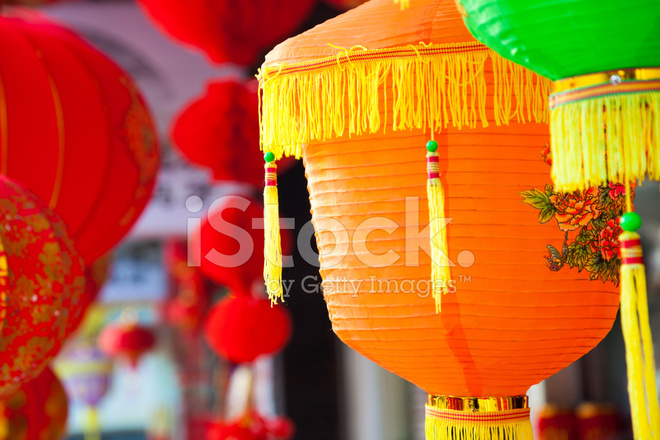 colorful chinese paper lanterns hanging in a street market stock