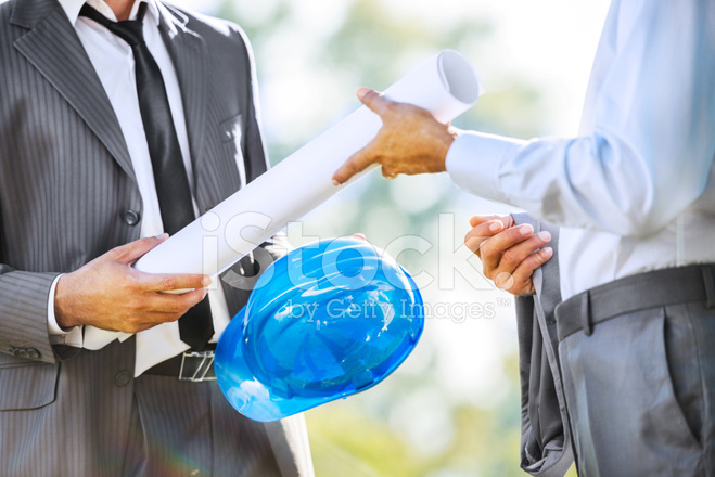 Male Architect Handing Over The Blueprints Stock Photos