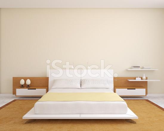 Moderne Witte Slaapkamer : Een moderne slaapkamer met witte muren en beddengoed stockfoto s