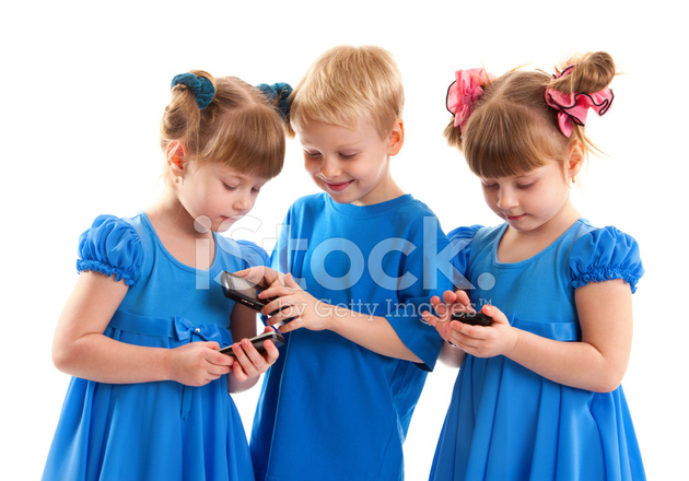 Two Girls And A Boy With Their Cell Phones Stock Photos