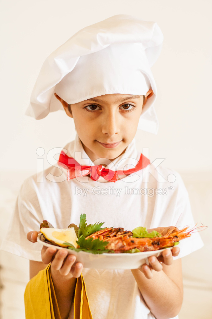 Boy Serving Food With Chef Hat Stock Photos FreeImagescom