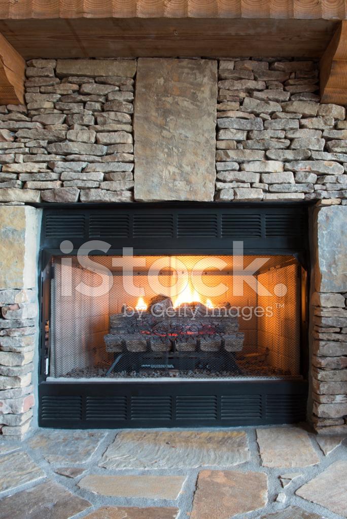 gas fireplace with stone surround stock photos