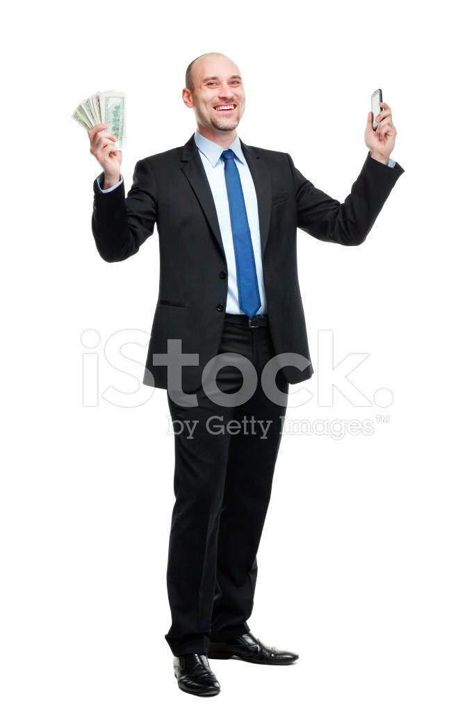 Uomo Felice Tiene Soldi E Telefono Isolato Su Sfondo Bianco