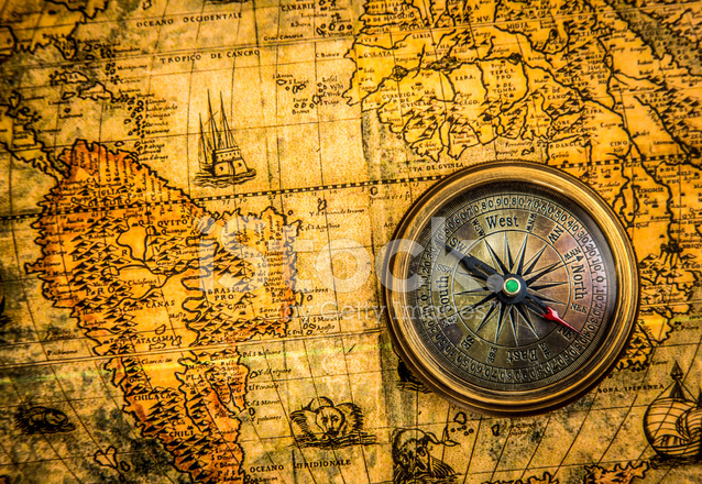 Vintage compass lies on an ancient world map stock photos premium stock photo of vintage compass lies on an ancient world map gumiabroncs Gallery