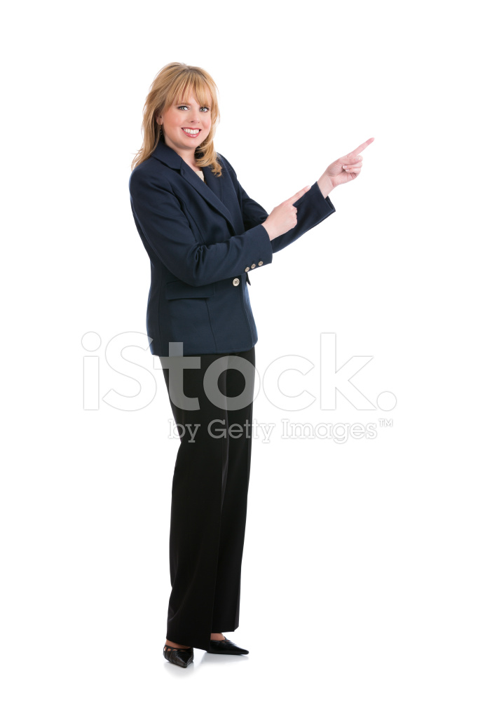 Full Body Portrait Of A Blond Businesswoman Pointing On
