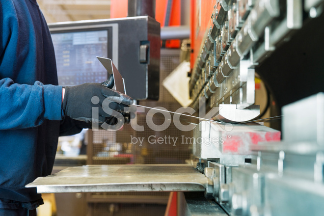 Brake Press Operator AT Work IN A Metal Factory Stock Photos