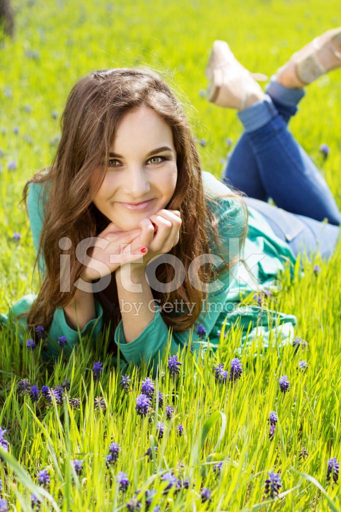 Beautiful Girl Laying on A Field Among Fresh Grass Stock ...