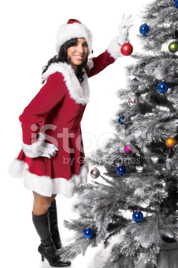 Miss Santa Claus Decorating Tree