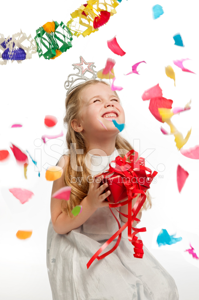 Happy Little Girl on Birthday Party With Falling Confetti