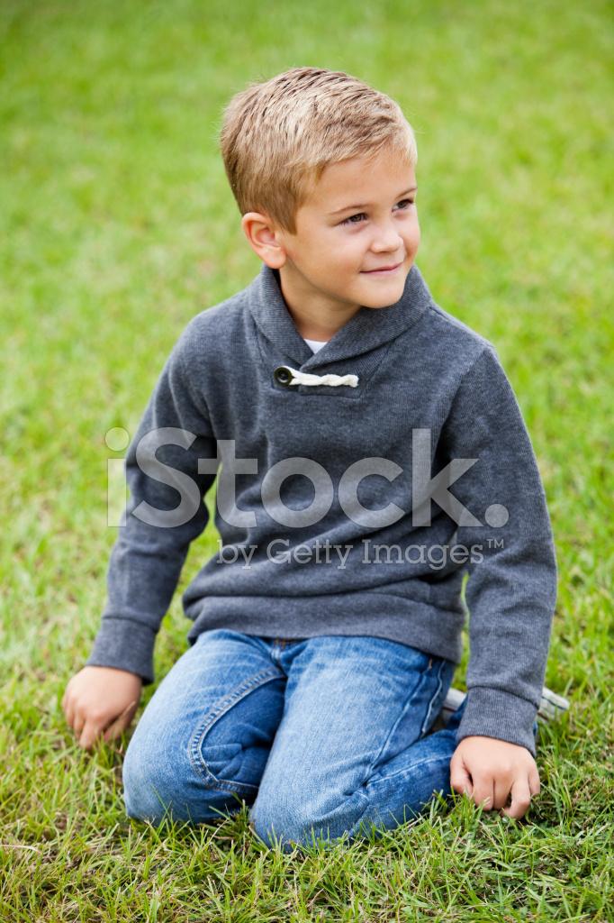 Little Boy Kneeling On Grass Stock Photos Freeimages Com