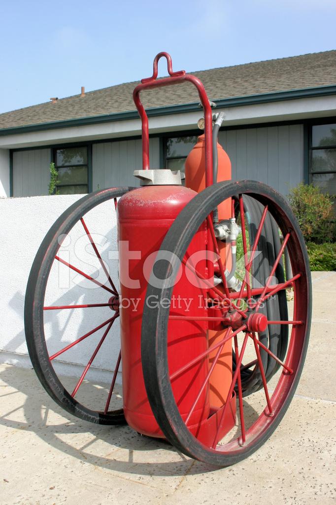 Vintage Large Wheeled Fire Extinguisher Stock Photos