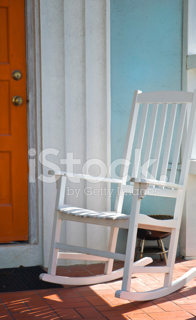 country porch with white rocking chair stock photos. Black Bedroom Furniture Sets. Home Design Ideas