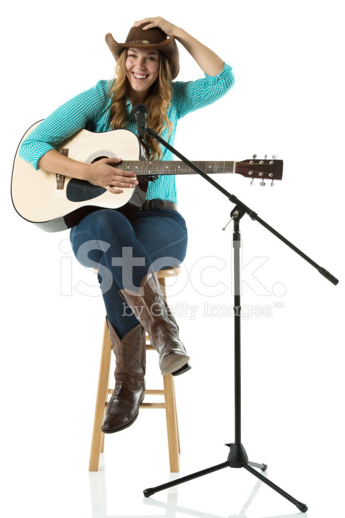 531c3b84be12c Happy Young Cowgirl Sitting With A Guitar Stock Photos - FreeImages.com