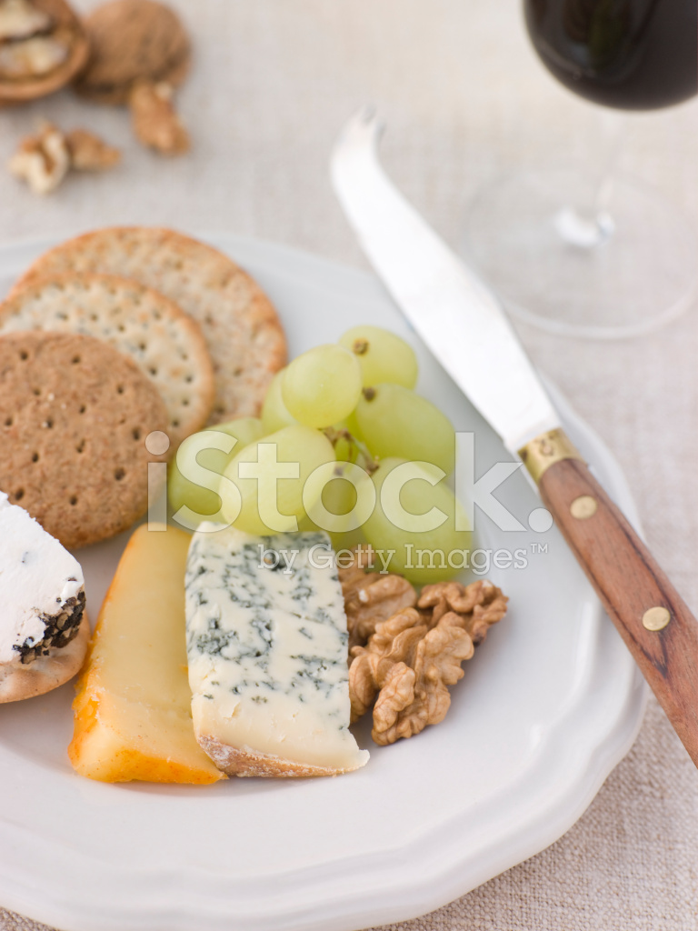 Cheese and biscuits with a glass of port stock photos for Table 52 goat cheese biscuits