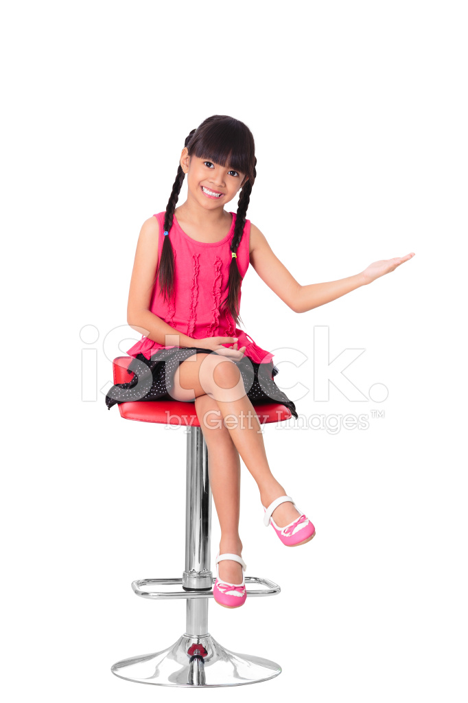 Happy Little Asian Girl Sitting On High Chair